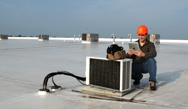HVAC tech using a mobile app