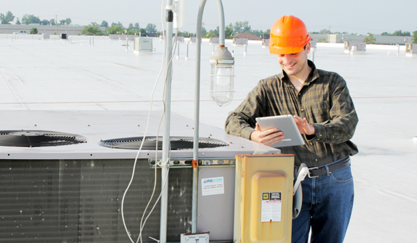 HVAC tech using mobile technology.